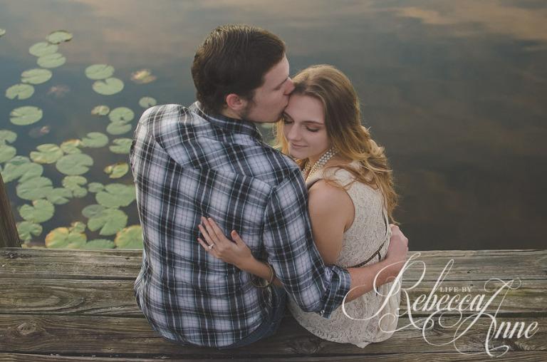 engagement couple, lake, couple, sunrise, smile, back, looking at sunrise, kiss