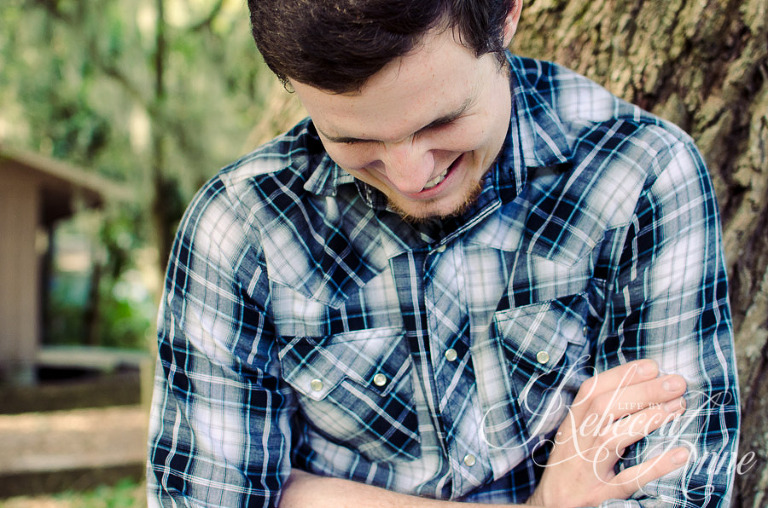 country, boy, man, plaid, smile, laugh, tree, leaning on tree