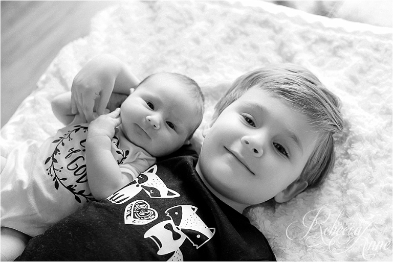 brother, sister, holding baby sister, smile, black and white